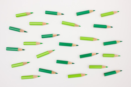 visualizing: Crowd of green colored pencils pointing in the same direction - abstract image visualizing leadership, business strategy, sucessful teamwork