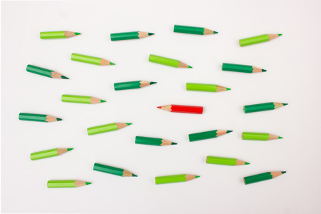 lay forward: Single red pen moving against the crowd - useful image for unique business strategy  idea, uniqueness, independence, initiative, strategy