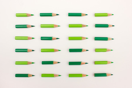 ordered: Many green pencils ordered point to the right - teamwork, team strategy concept