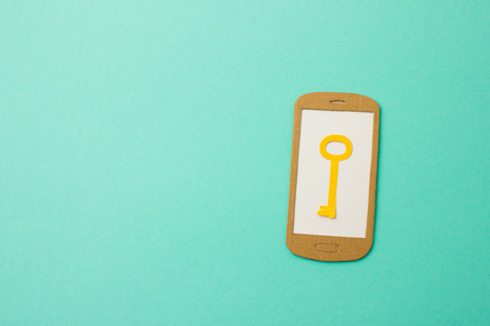 handmade paper: Handmade paper model of smartphone with key icon - useful illustration  background image for mobile data security