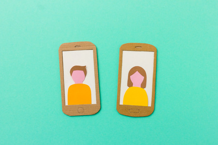 messaging: Profile of boy and girl on smartphone - useful image for social network, mobile messaging app with space for text available Stock Photo