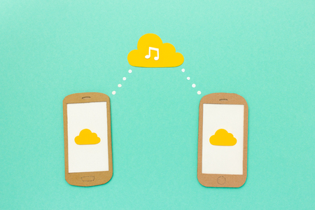 cloud service: Cloud music concept - smartphones playing music tracks from cloud service