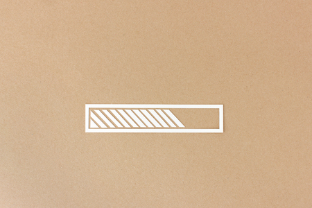 hand cut: Progress or loading bar - hand cut on brown paper