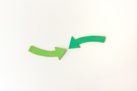 combined effort: Two arrows pointing together - combined approach