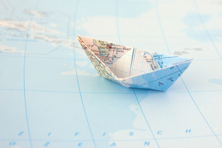 Paper boat on map Stock Photo