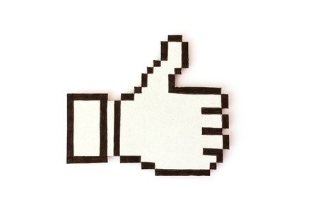 Positive feedback - Thumb up icon made from cardboard