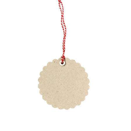 Blank hanging gift tag made from  eco-friendly kraft paper with red twine - isolated on white background