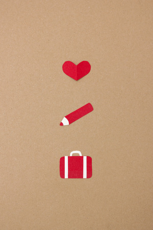 love is it: Heart, pen and suitcase - handmade paper collage to illustrate the quote Love it, change it or leave it