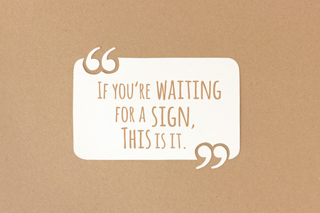 If youre waiting for a sign, this is it. Motivational quote on paper Stock Photo