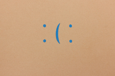 Happy smiley or sad looking emoticon - paper illustration with space for your text or quote