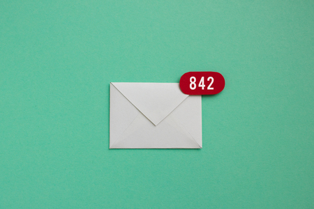 Inbox over load - envelope with red app notification bubble badge showing there are 842 unread emails waiting to be answered