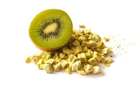 Freeze dried and fresh kiwi on a white background. Lyophilization. Food for astronauts