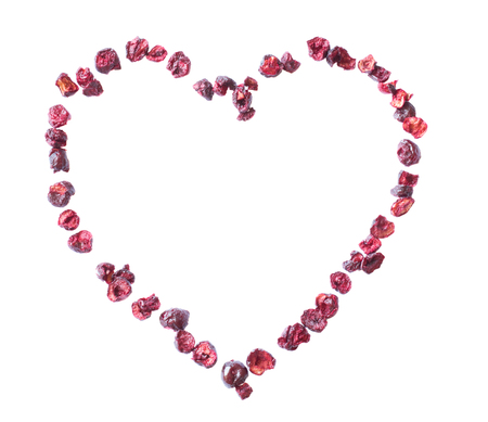 Freeze dried cherry on a white background in the form of heart. Lyophilization. Food for astronauts. Isolated Stock Photo