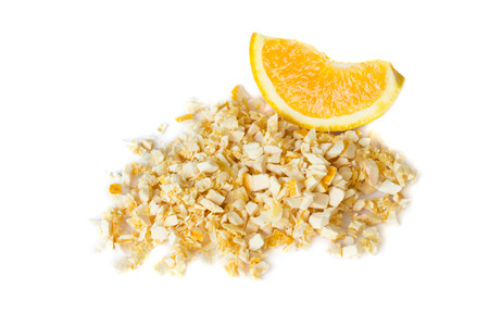 Freeze dried and fresh orange on a white background. Isolated. Lyophilization. Food for astronauts Фото со стока