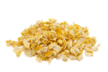 Freeze dried orange on a white background. Lyophilization. Food for astronauts. Isolated