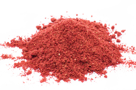 Freeze dried strawberries on a white background, powder Lyophilization. Food for astronauts. Isolated