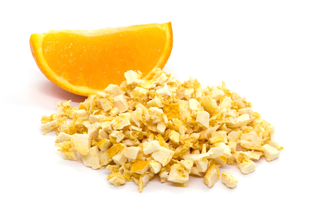 Freeze dried and fresh orange on a white background. Lyophilization. Food for astronauts. Isolated Stock Photo