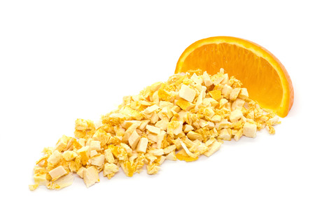 Freeze dried and fresh orange on a white background. Lyophilization. Food for astronauts. Isolated Фото со стока