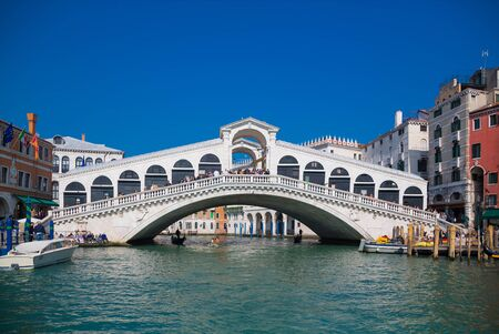 VENICE, ITALY - March 24, 2019: Venice Grand canal with gondolas and Rialto Bridge, Italy in spring bright day. Éditoriale
