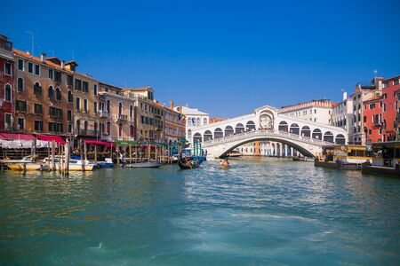 VENICE, ITALY - March 24, 2019: Romantic spring scene of famous Canal Grande. Colorful morning panorama with Rialto Bridge. Picturesque cityscape of Venice, Italy, Europe. Traveling concept background