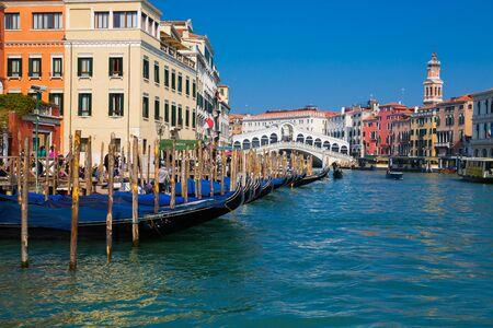 VENICE, ITALY - March 24, 2019: Rialto bridge and Grand Canal in Venice, Italy. View of Venice Grand Canal with gandola. Architecture and landmarks of Venice. Venice postcard. Redakční
