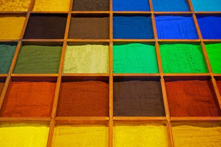 Colorful background made of Indian dyes.