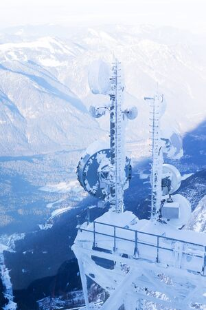 Communication tower on snowy mountain, The Zugspitze at 2,962 m, Garmisch-Partenkirchen, Germany