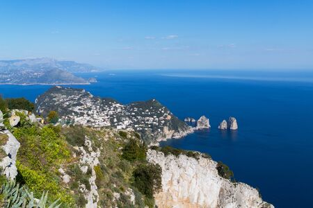 Italy, Capri, panoramic view of the famous Faraglioni.