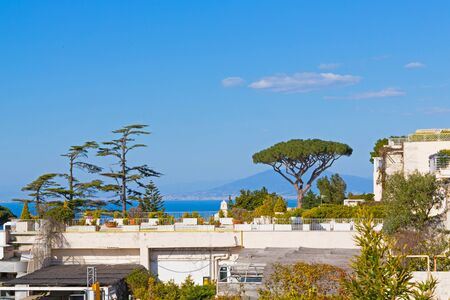View of the beautiful courtyard against the background of the Tyrrhenian sea and volcano Vesuvius. Capri landscape.