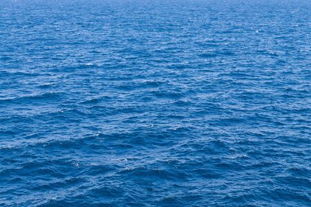 Clear blue sea in calm, water seascape abstract background. 写真素材