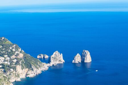 Faraglioni cliffs and Tyrrhenian Sea on Capri Island, Italy. 스톡 콘텐츠 - 131952423