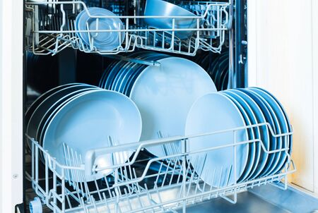 Open dishwasher with clean dishes after cleaning process. Stock fotó
