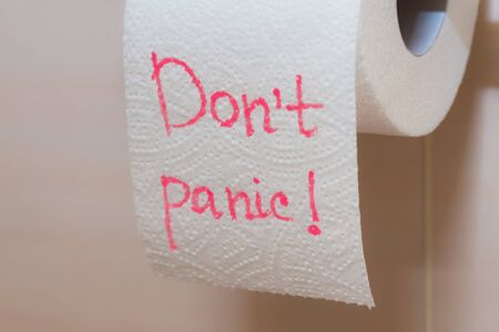 The inscription on the toilet paper - Dont panic. Toilet paper close up.