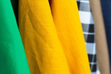 Natural yellow linen dress on market.