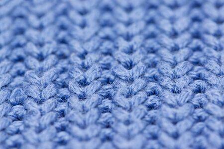 Macro of blue woolen pattern, close up.