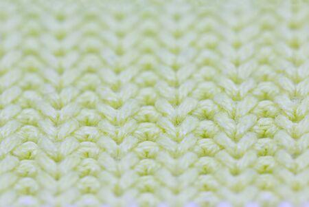 Macro of yellow woolen pattern, close up.