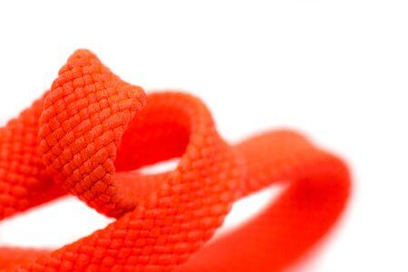 Orange shoelaces, close up, isolated on a white background. Banco de Imagens
