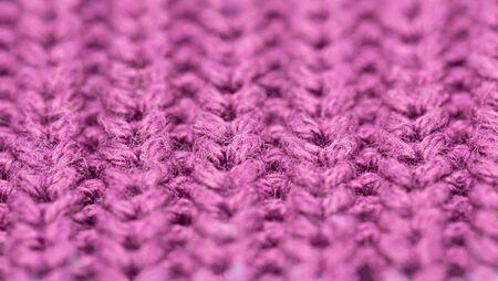 Macro of violet woolen pattern, close up.