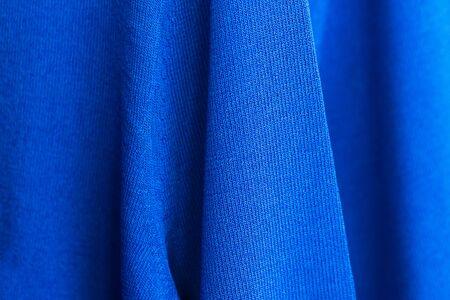 Knitwear blue sweater texture, close up.
