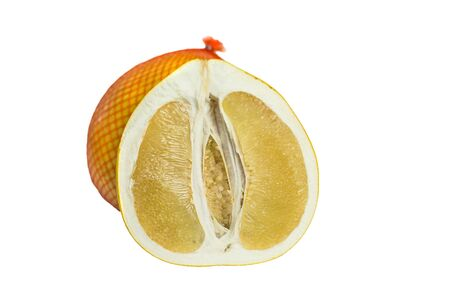 Cut pomelo on the background of a whole pomelo in the gridon on white background Banco de Imagens
