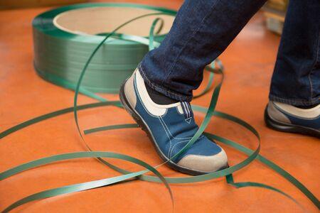 Leg tangled in tape. accident on work or job. Insurance