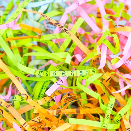 Detailed close up background of colorful shredded paper. Selective focus