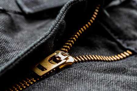Black jeans with lock zipper. Close up background