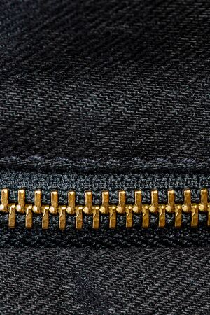 Macro vertical close up look of zipper replacemeant part, background