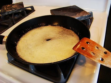 Melting the butter for cooking photo