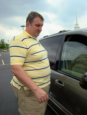 overweight people: Shopping for a car Stock Photo