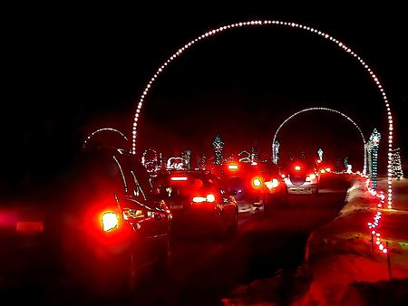 Cartoon illustration of Christmas lights decoration and cars entering the Wonderland Park Stock Illustration - 2290682