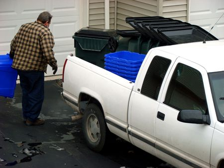 Man delivering garbage containers photo