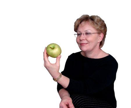 Woman holding a fresh green apple photo