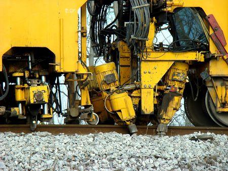 Heavy machinery repairing the train tracks